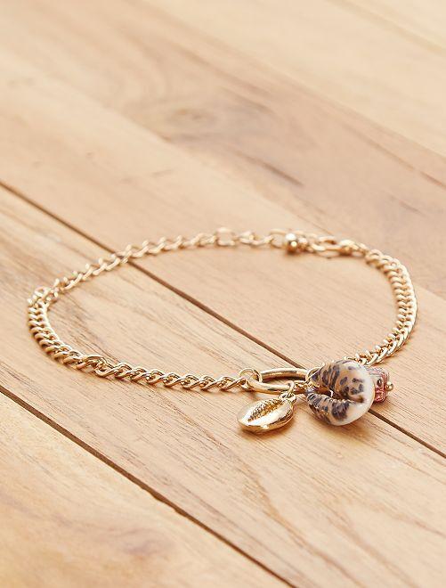 Bracelet chaîne et coquillage                             doré