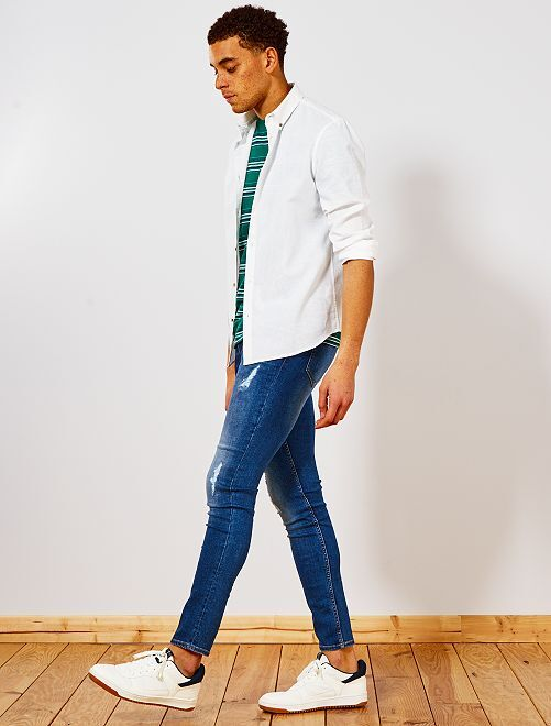 Jean skinny à abrasions                             stone Homme