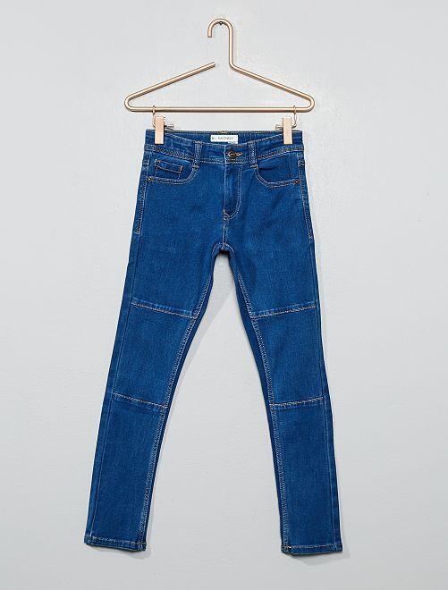 Jean skinny stretch avec découpes                                         bleu