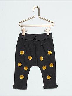 Pantalon à pompons