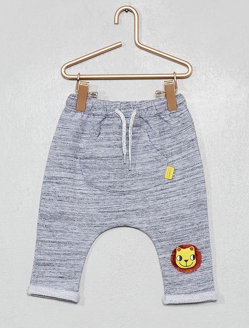 Pantalon poche kangourou 'lion'                             gris