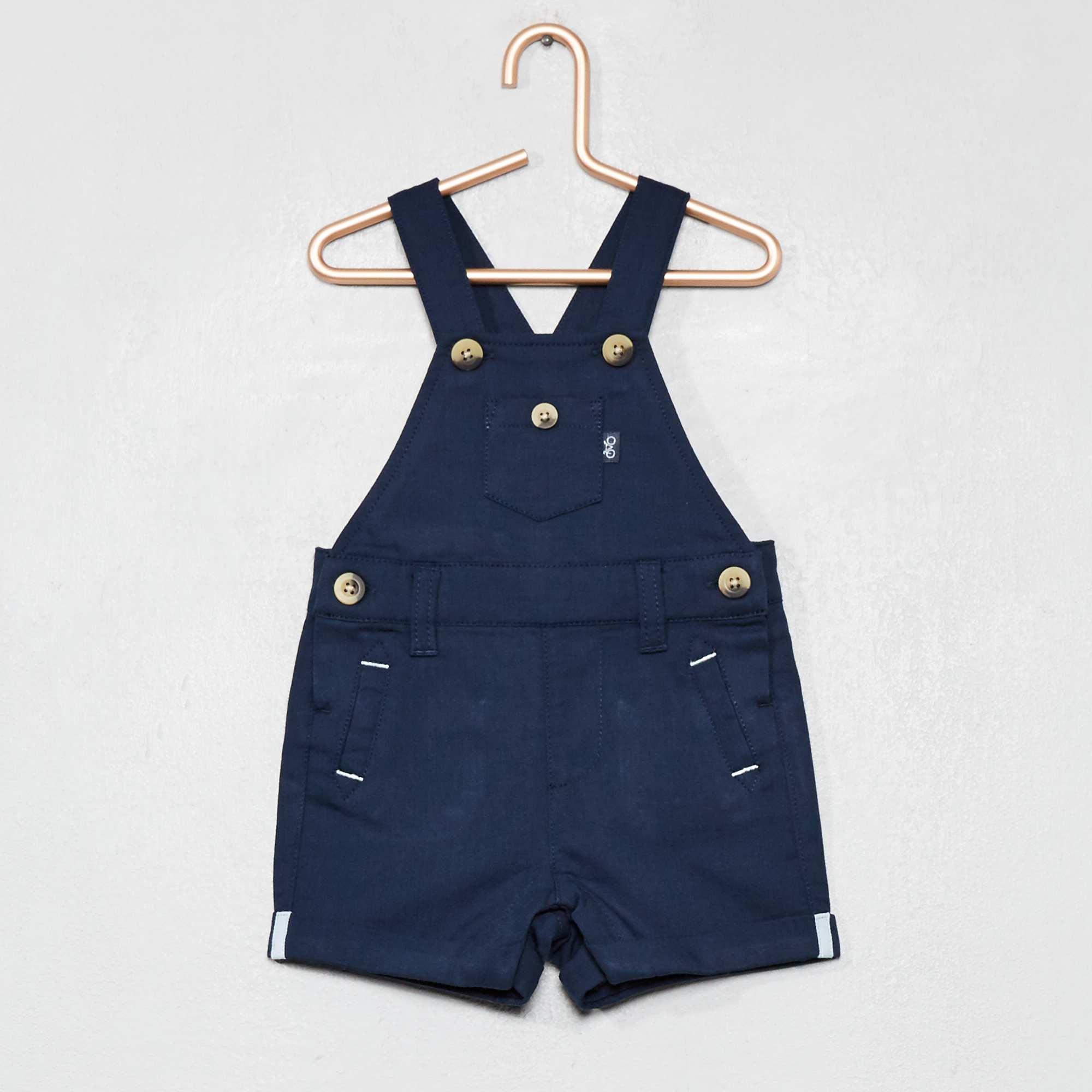 879a44378d Salopette short en toile pur coton bleu marine Bébé garçon. Loading zoom