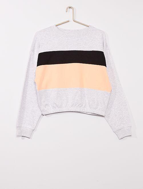 Sweat color bloc                                         gris/noir/orange
