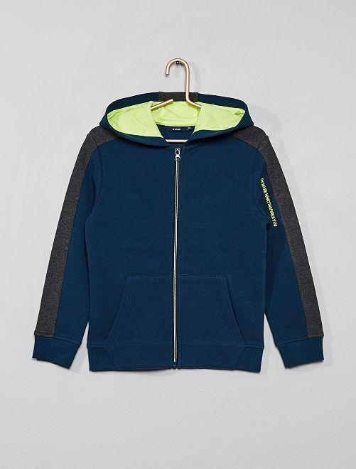 Sweat zippé à capuche                                         bleu/gris