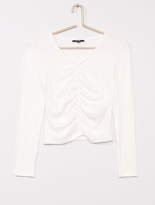 Un t-shirt chaud élastiqué devant                                         blanc